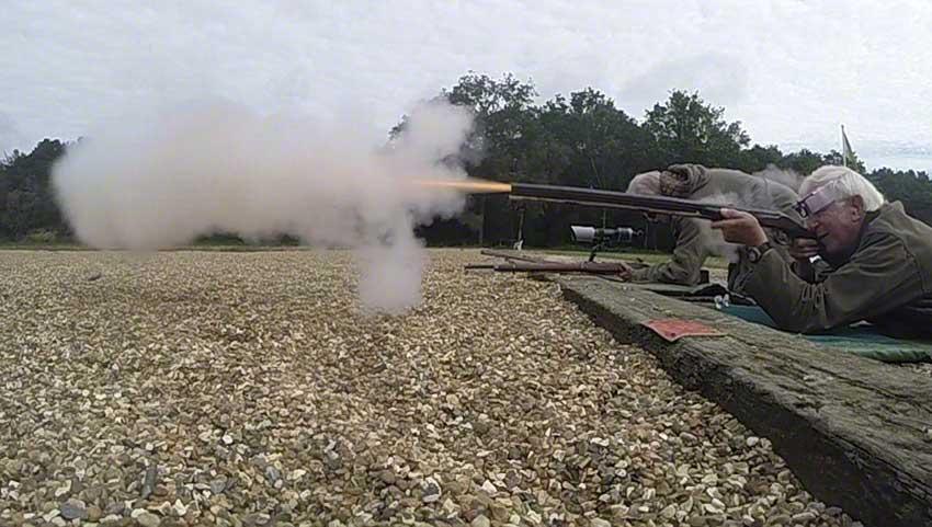 Big-game rifle: Flame and smoke emerge.
