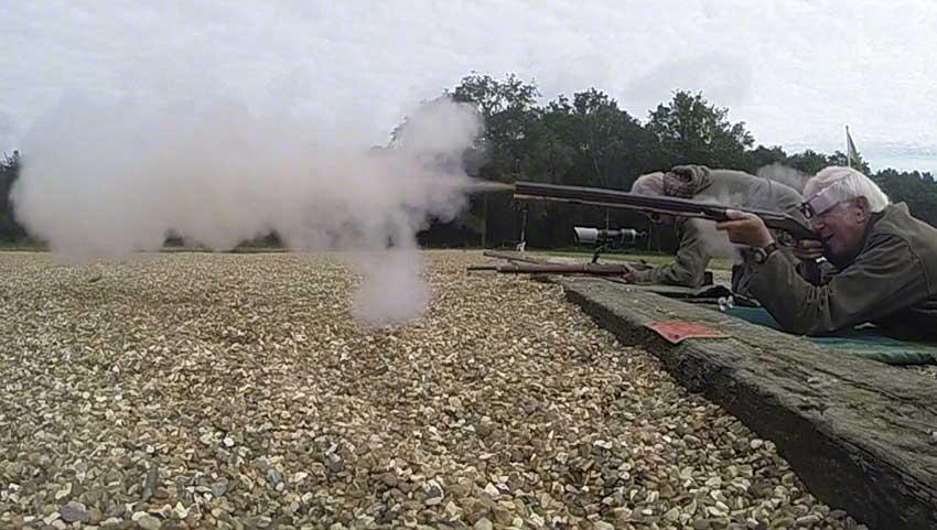 Big-game rifle: Smoke and debris emerge.